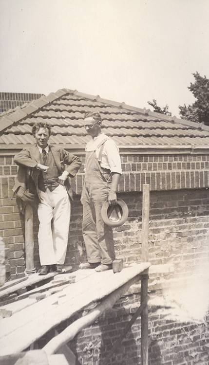 Percy Grainger and Frank Hansen on west end of roof scaffolding.