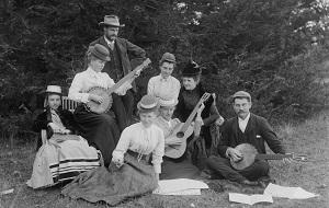 People playing banjos and guitars
